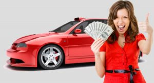 happy woman holding money, red car